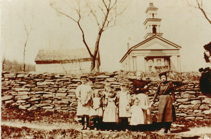 Old Group Picture taken in front of church at Bloomville